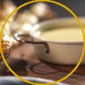Grissini di sfoglia alla salsiccia con fonduta di formaggi e curcuma