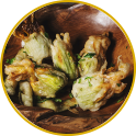 Fried zucchini flowers filled with smoked scamorza cheese and cooked ham