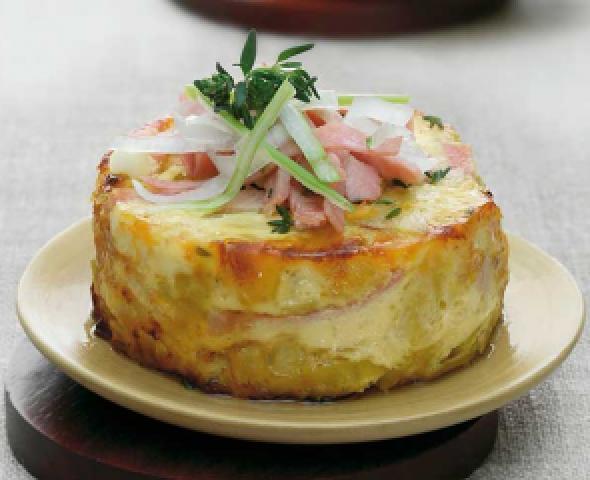 Mini-Quiche aus Kartoffeln, mit Robiola und Speck